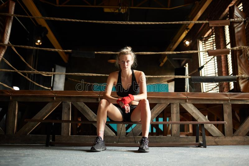 Tough Woman by Boxing Ring stock photography