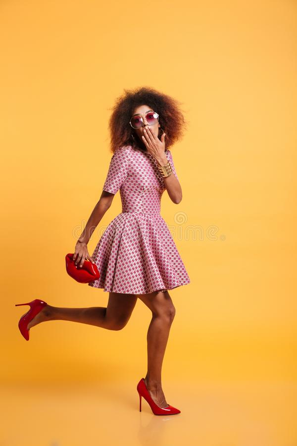 Full length portrait of a surprised cute afro american woman stock photography