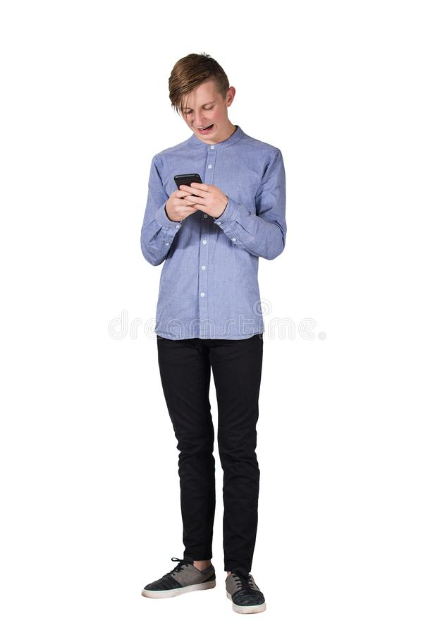 Full length portrait of teen boy using his smartphone being stressed and desperate after bullying on social media isolated over royalty free stock photo