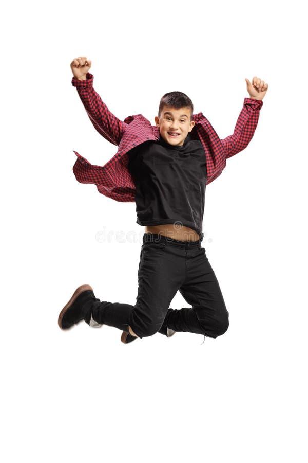 Teenage boy jumping stock photo