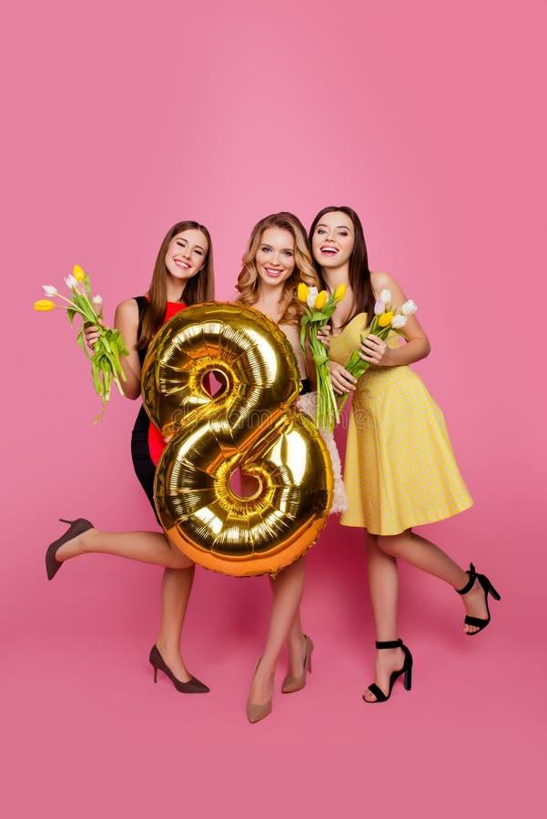 Full length portrait of three trendy, pretty, attractive girls w royalty free stock photos