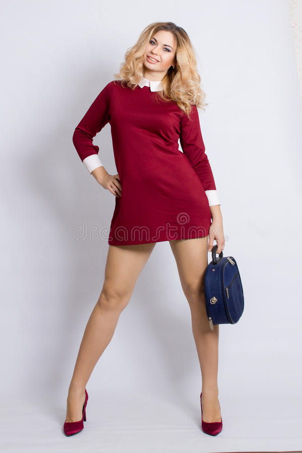 Full length portrait of trendy young woman stock image