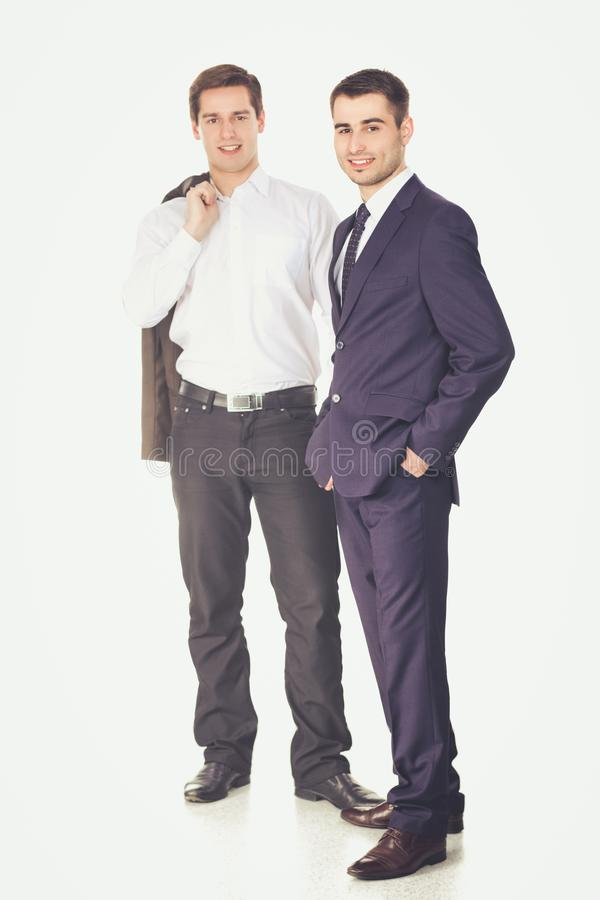 Full length portrait of two businessmen standing together royalty free stock photography