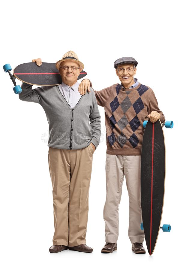 Two elderly men with longboards. Full length portrait of two elderly men with longboards isolated on white background royalty free stock photo