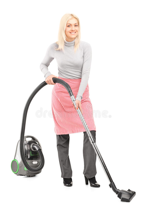 Full length portrait of a woman cleaner with hover. On white background royalty free stock photography