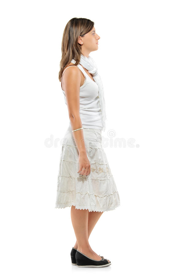 Full length portrait of a woman standing in a line. Against white background stock photography
