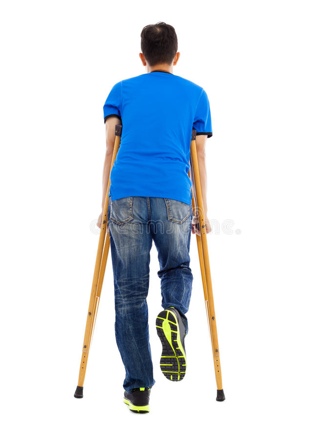 Full length portrait of Young asian man on crutches stock image