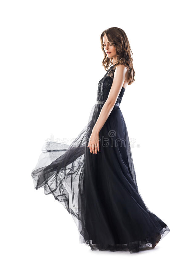 Full length portrait of young beautiful woman in black evening d stock images