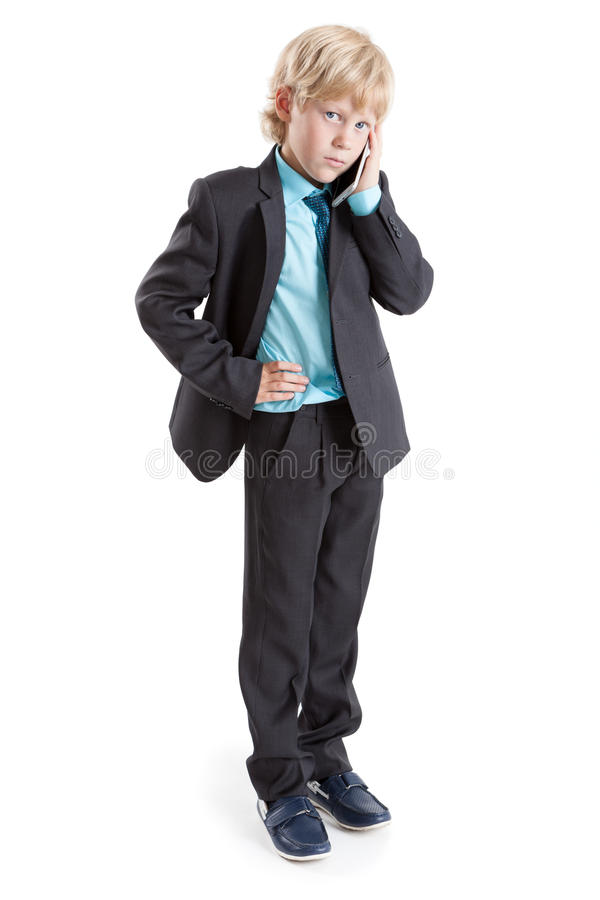 Full length portrait of young boy a businessman standing white background with mobile phone in hand. Full length portrait of young boy a businessman standing on stock images