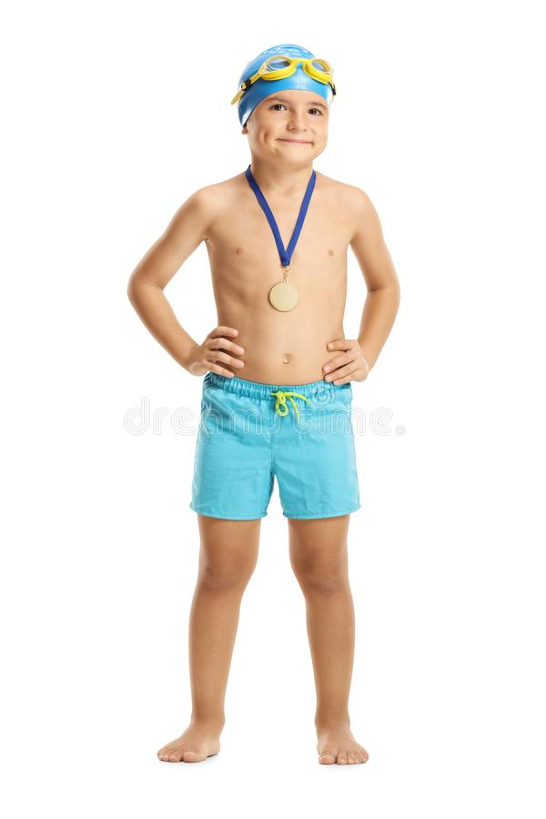 Young boy swimmer with a gold medal royalty free stock images