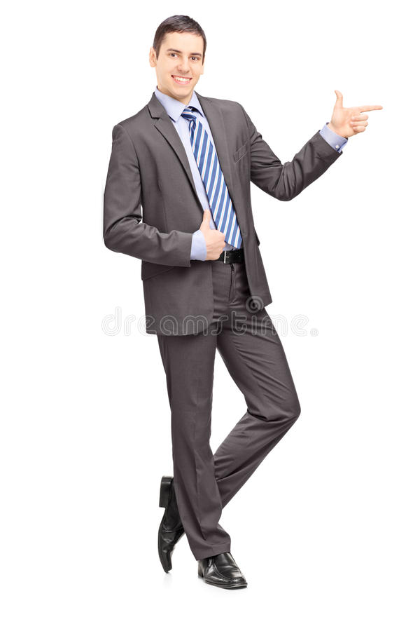 Download Full Length Portrait Of A Young Businessman Leaning Against Wall Stock Photo - Image: 31851256