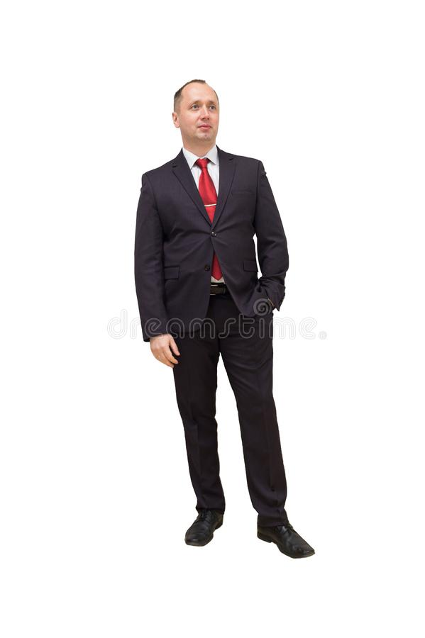 Full length portrait of a young businessman standing with his hands in the pockets. Isolated on white. Clipping path stock photo