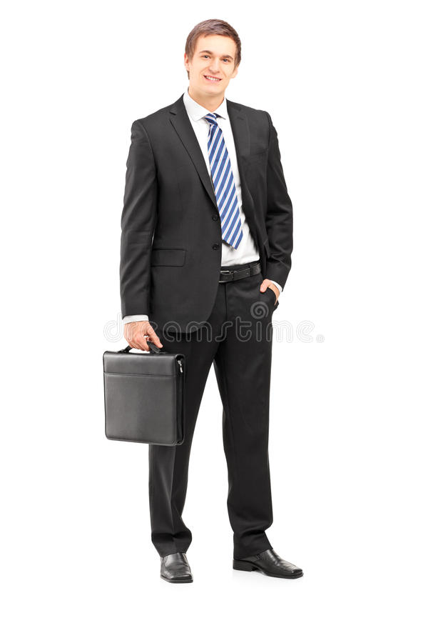 Full length portrait of a young businessman in suit holding a suitcase stock images