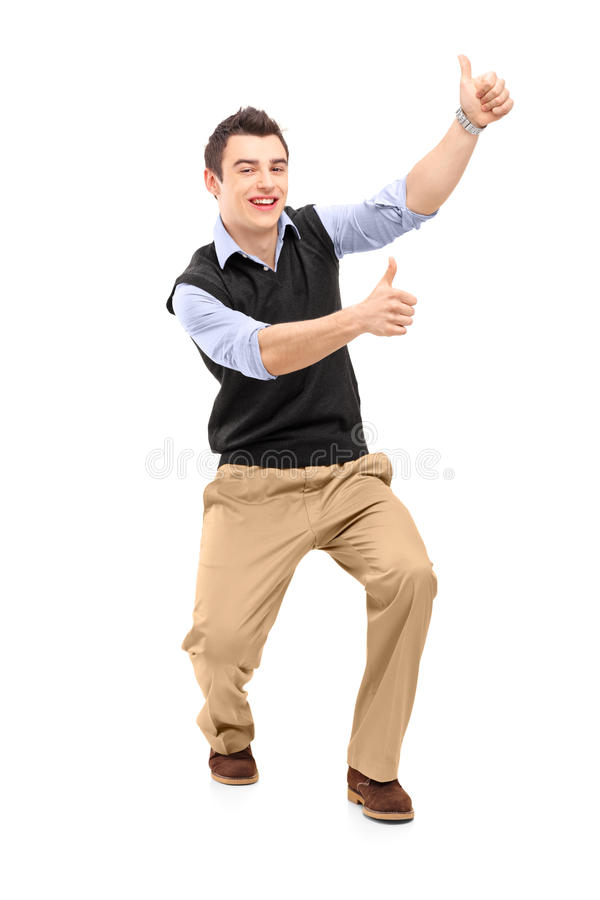 Full Length Portrait Of A Young Cheerful Man Gesturing Happiness Stock Image