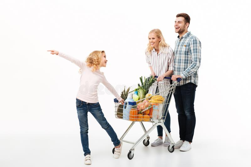 Full length portrait of a young family stock photos