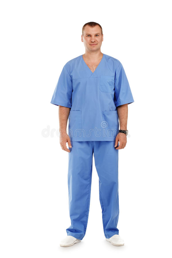 Full length portrait of a young male doctor in a medical surgical blue uniform. Against a white background stock photo