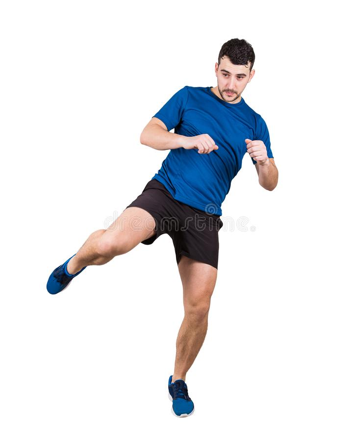 Full length portrait of young man athlete or fighter making a leg kick isolated over white background royalty free stock photography