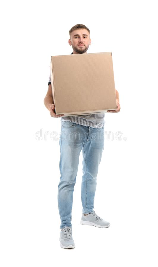 Full length portrait of young man carrying carton box on white background. stock images