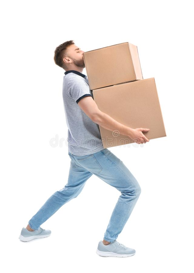 Full length portrait of young man carrying carton boxes royalty free stock photos