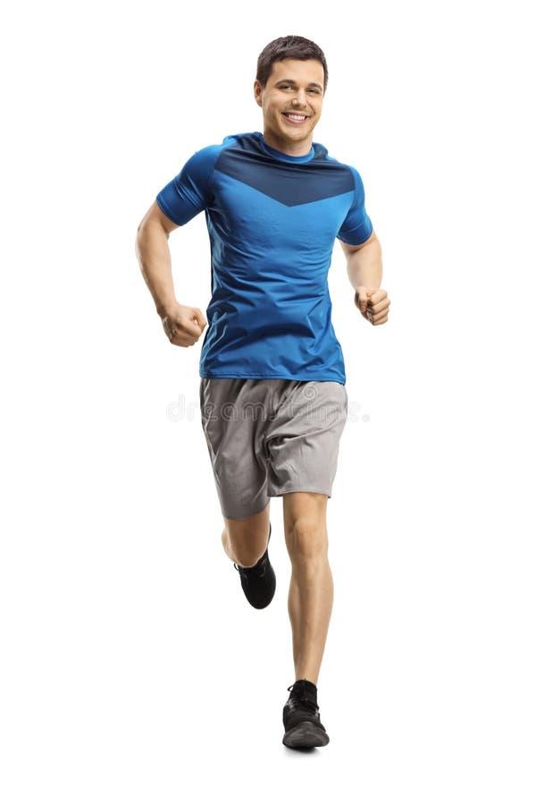 Young man jogging towards the camera royalty free stock photos