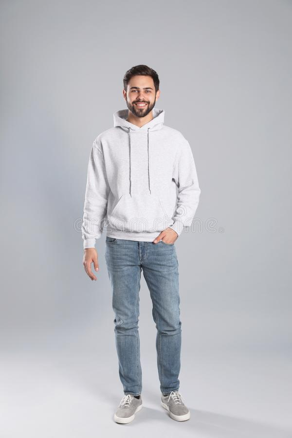 Full length portrait of young man in sweater on background. Mock up for design royalty free stock photography