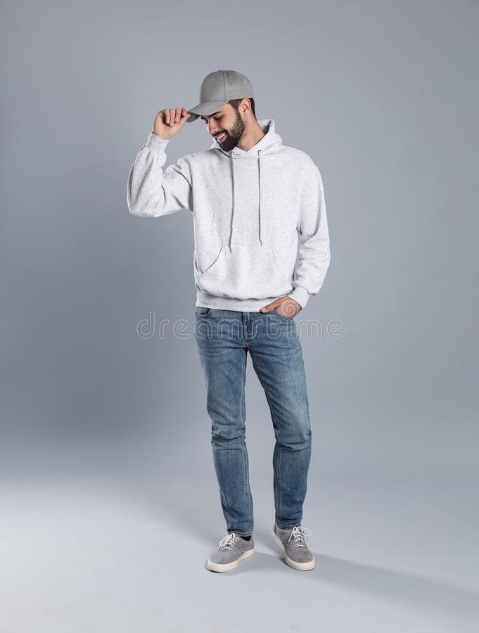 Full length portrait of young man in sweater on background. Mock up for design stock photos