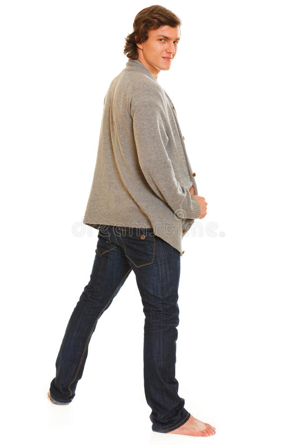 Full length portrait of young man turn back. Full length portrait of young male turn back royalty free stock image