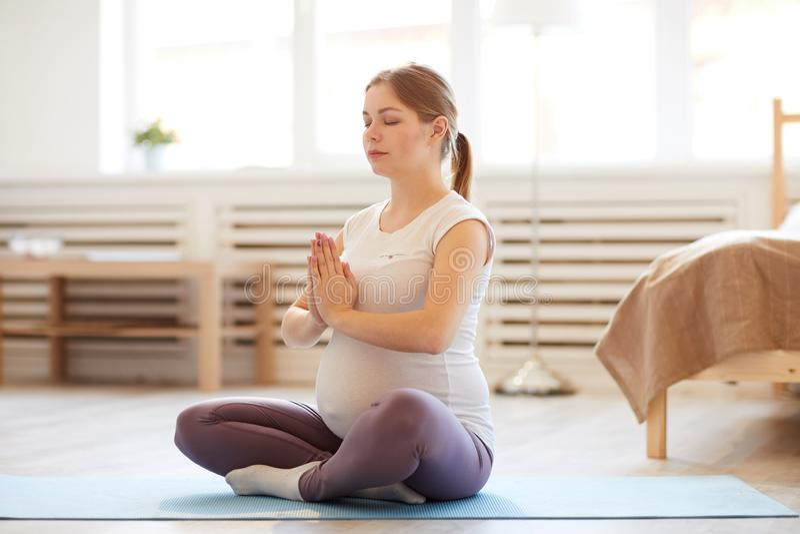 Pregnant Woman Meditating stock image