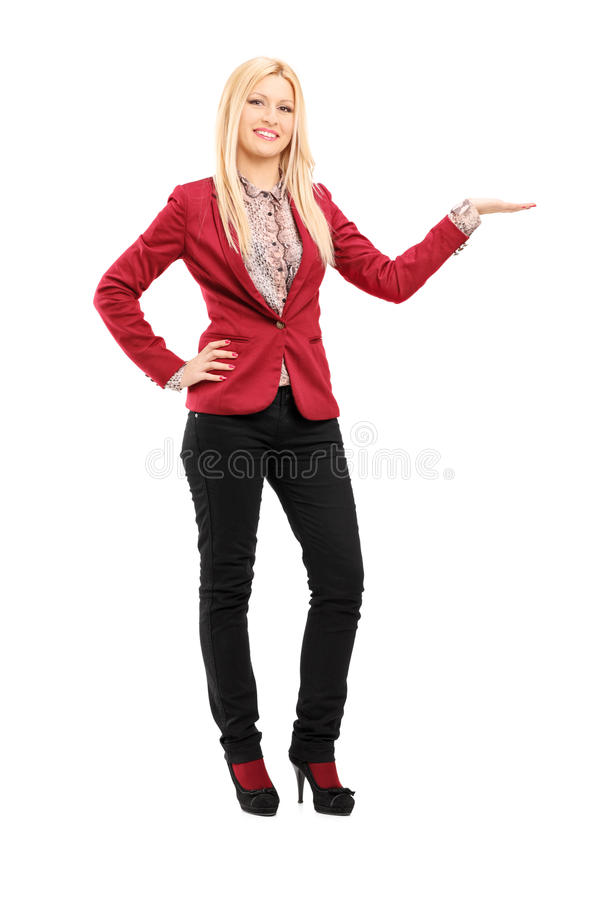 Full Length Portrait Of Young Smiling Woman Gesturing Royalty Free Stock Photos
