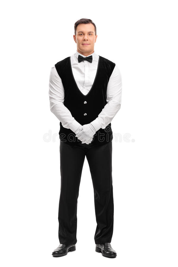 Full length portrait of a young waiter stock image