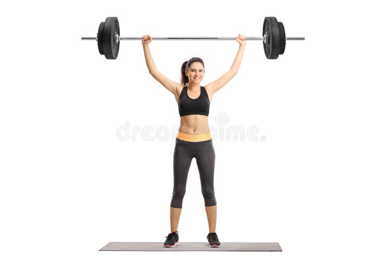 Young woman exercising with a barbell stock image