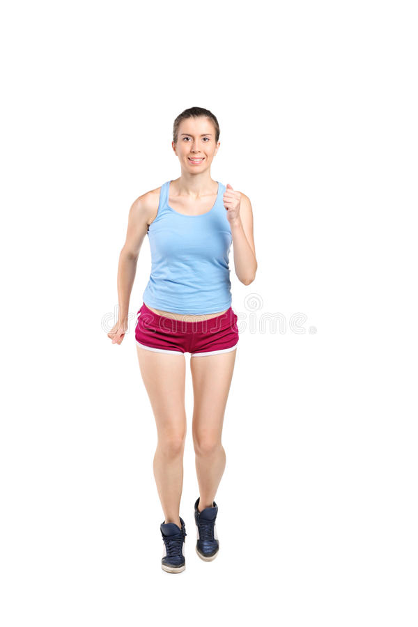 Full length portrait of a young woman jogging royalty free stock photos