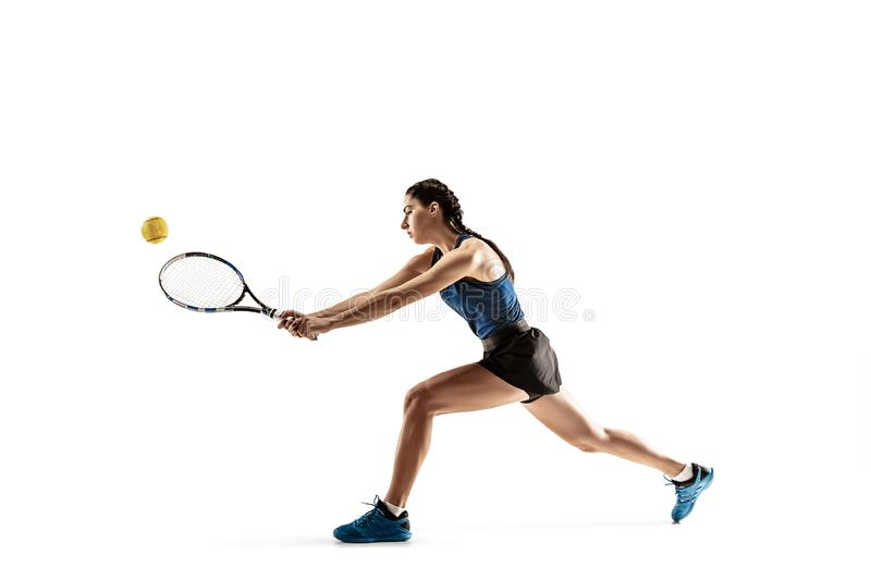 Full length portrait of young woman playing tennis isolated on white background stock image