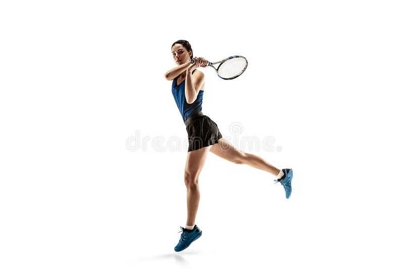 Full length portrait of young woman playing tennis isolated on white background stock photography