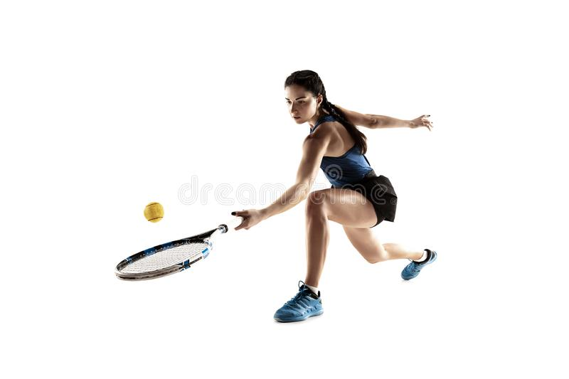 Full length portrait of young woman playing tennis isolated on white background royalty free stock photography