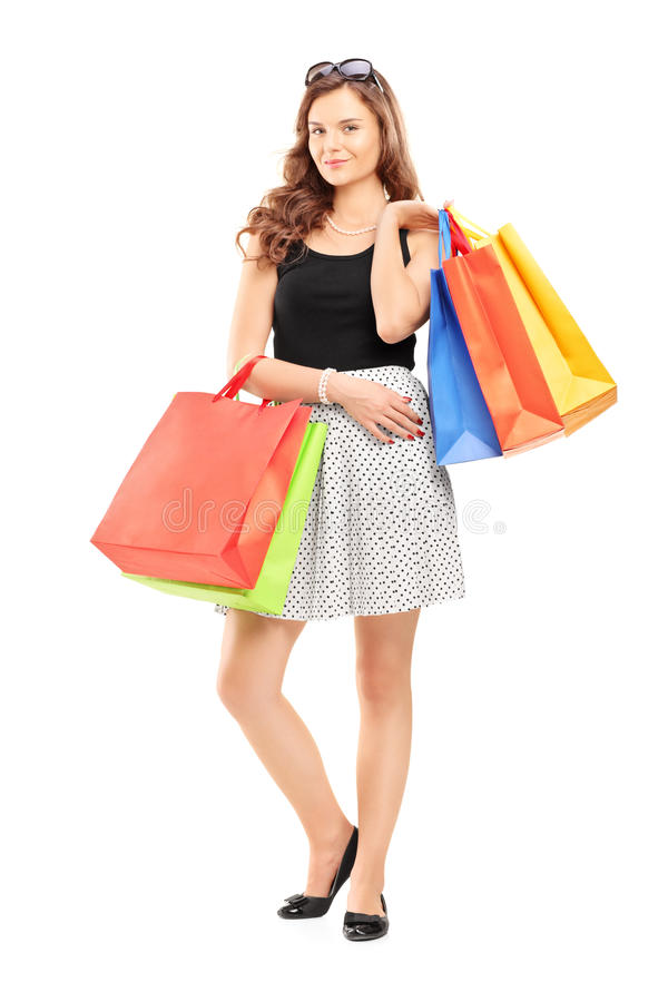 Full Length Portrait Of A Young Woman Posing With Shopping Bags Royalty Free Stock Photos