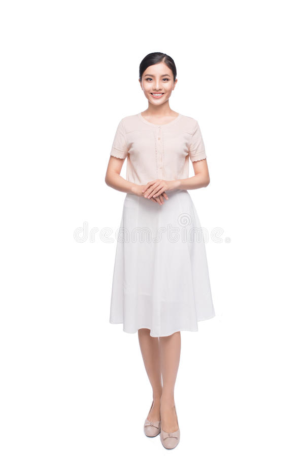Full length of pretty young Vietnamese girl standing. stock image