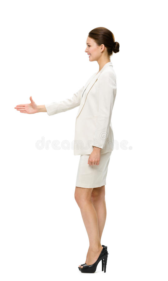 Full-length profile of business woman handshaking royalty free stock photography