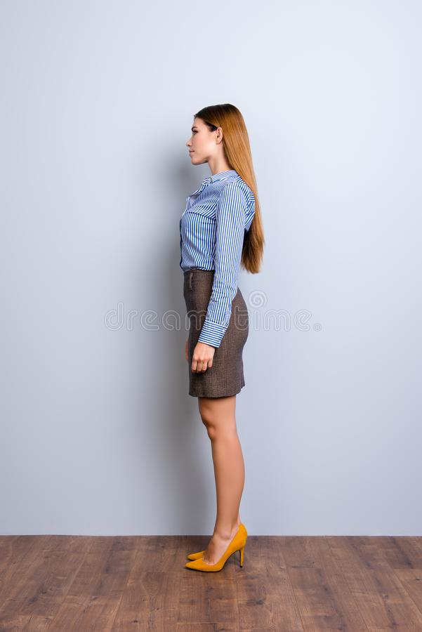Full length profile portrait of serious young business lady in s royalty free stock image