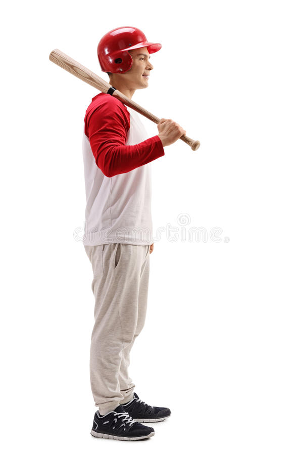 Full length profile shot of a baseball player with a bat. Isolated on white background stock image