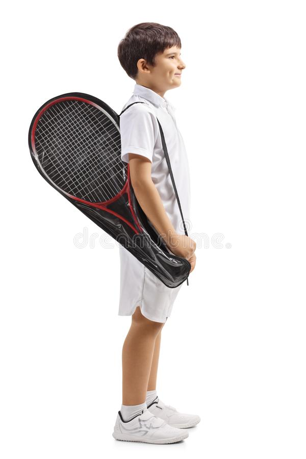 Child carrying a tennis racket in a case. Full length profile shot of a child carrying a tennis racket in a case isolated on white background royalty free stock photography