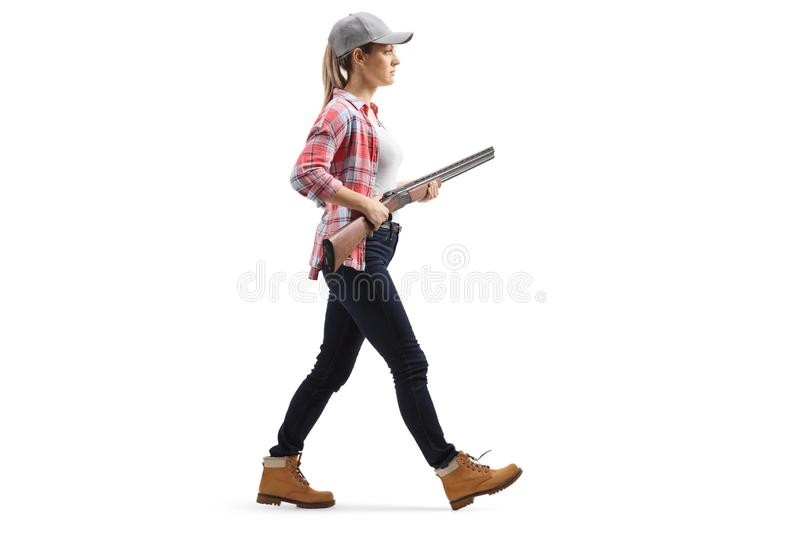 Female walking with a shotgun stock images