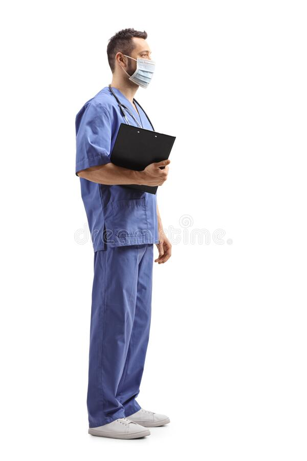 Full length profile shot of a medical worker in a blue uniform with a face mask stock image
