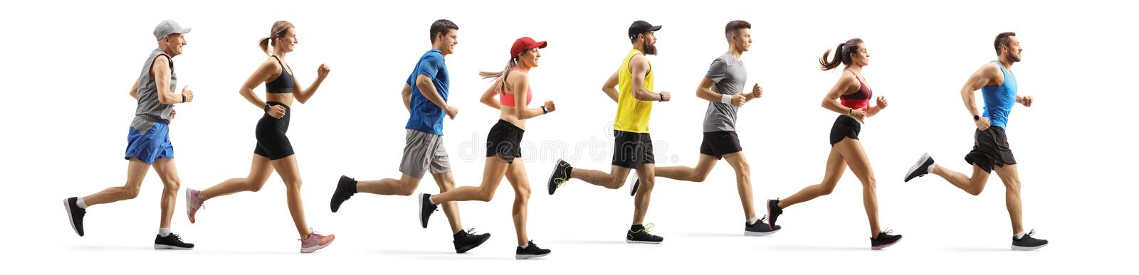 Men and women running a marathon royalty free stock photo