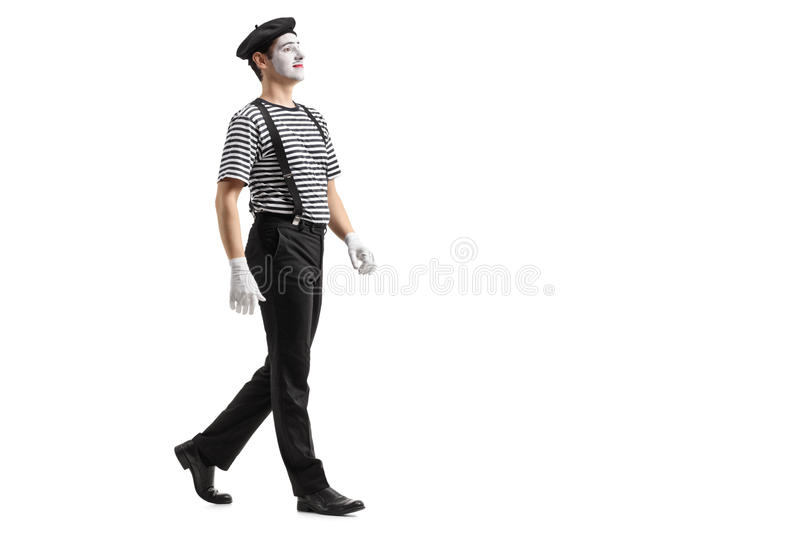 Full length profile shot of a mime walking. Isolated on white background stock photos