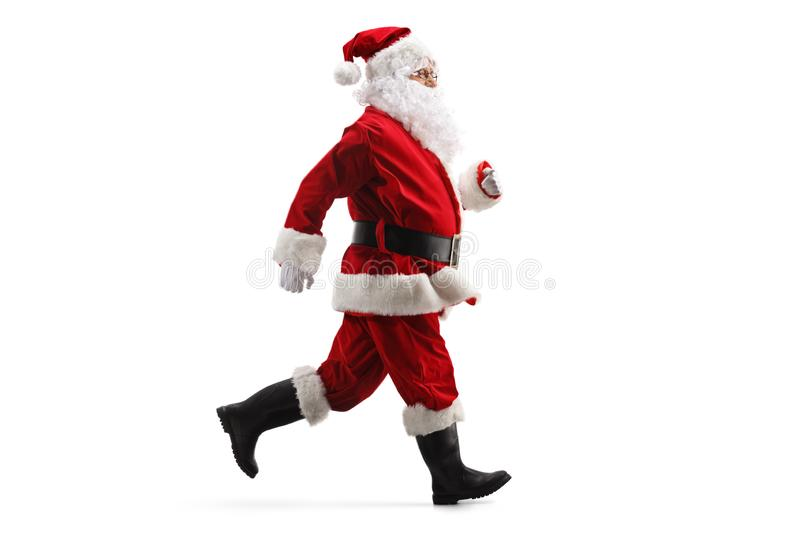 Santa Claus running fast. Full length profile shot of Santa Claus running fast isolated on white background stock photography