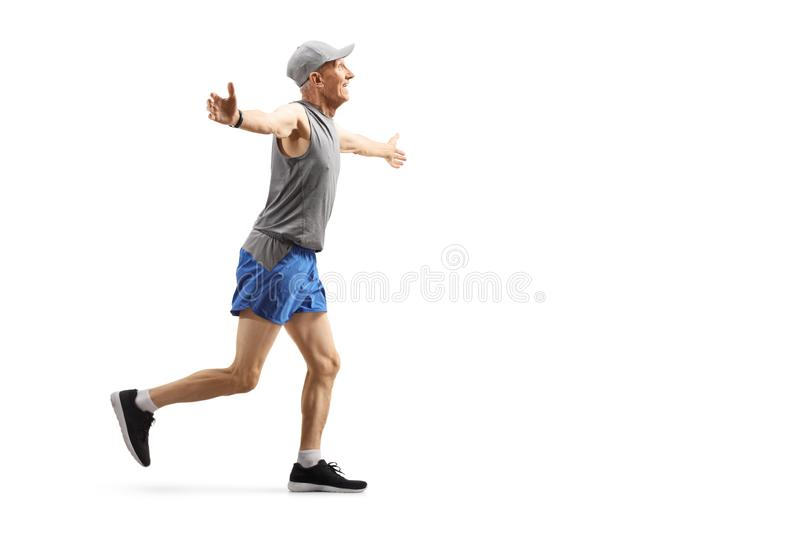 Senior man running and spreading arms stock photography