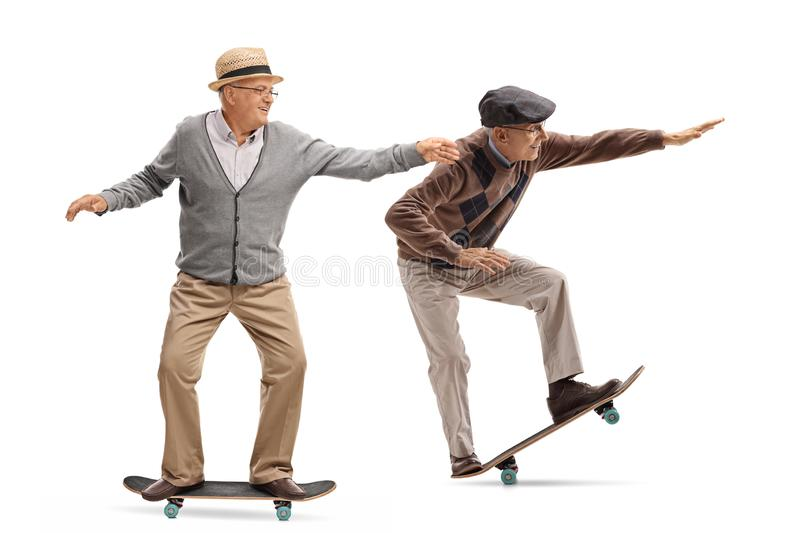 Two elderly men skateboarding royalty free stock photos
