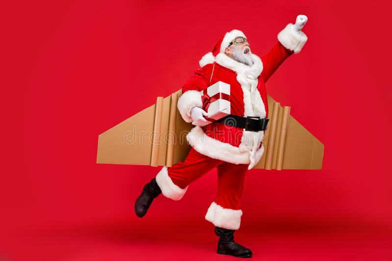 Full length profile side photo of excited elderly super christmas father travel launch fly up to give presents on noel royalty free stock photos