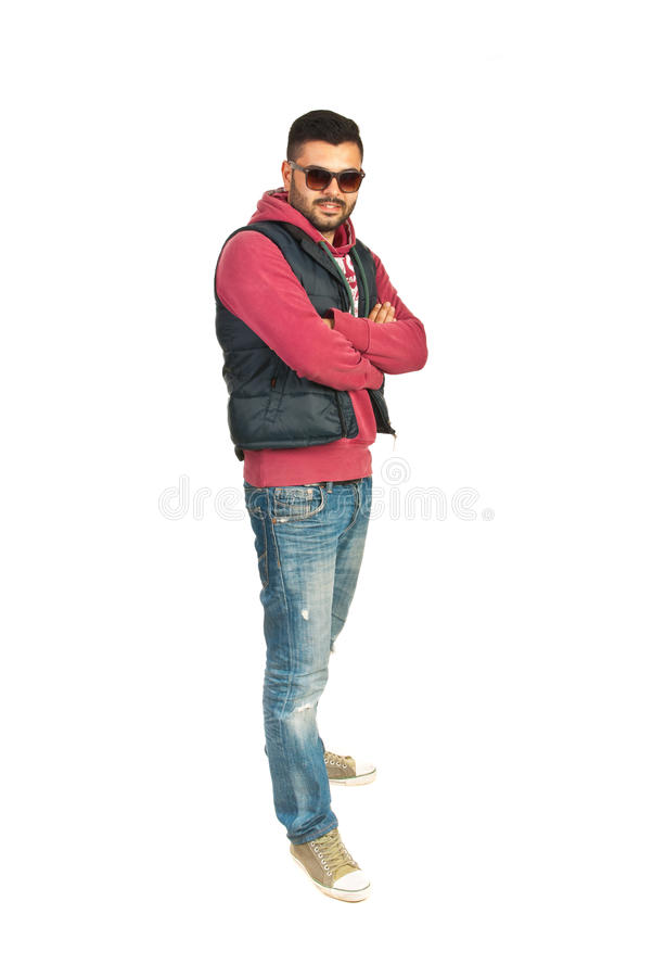 Full length of rapper man. Standing with arms folded isolated on white background stock photo
